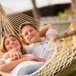 Couple relaxing in tropical hammock — Stock Photo #47044311