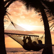 Couple relaxing in tropical hammock — Foto de Stock
