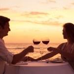 Couple enjoying romantic sunnset dinner — Stock Photo