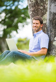 Man working on Laptop Outside — Stock Photo
