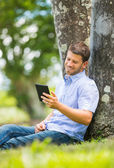 Man reading E-Book — Stock Photo
