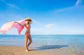 Woman walking on tropical beach — Stock Photo