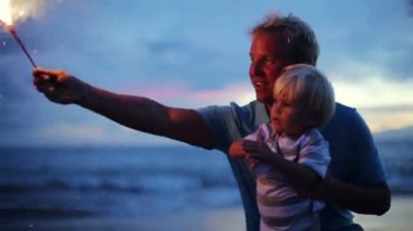 Father and son lighting fireworks — Stock Video