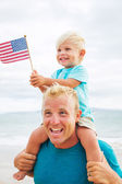 Father and son playing on the beach — Stock Photo