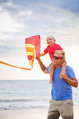 Father and son playing with kite — Stock Photo
