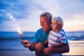 Father and son lighting fireworks — Стоковое фото