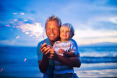 Father and son lighting fireworks — Stock Photo