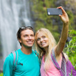 Couple taking pictures together on hike — Stok fotoğraf #50499535
