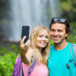 Couple taking pictures together on hike — Foto Stock #50499569