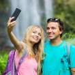 Couple taking pictures together on hike — Stok fotoğraf #50499575