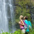 Couple hiking to waterfall — Stock Photo #50499623