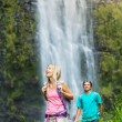 Couple hiking to waterfall — Stock Photo #50499649