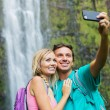 Couple taking pictures together on hike — Foto de Stock