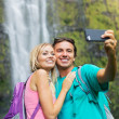 Couple taking pictures together on hike — Foto Stock #50499741