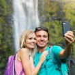 Couple taking pictures together on hike — Foto Stock #50499757