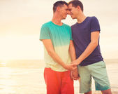 Gay couple on the beach — Stock Photo