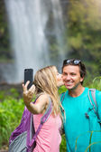 Couple taking pictures together on hike — Stock Photo