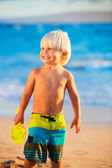 Young boy playing at the beach — Stock Photo