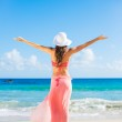 Happy woman at the beach — Stock Photo #51479553