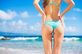 Sexy woman in small bikini on the beach — Stock Photo