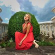 Stock Photo: Young womin red dress
