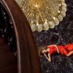 Girl on the marble floor — Stock Photo