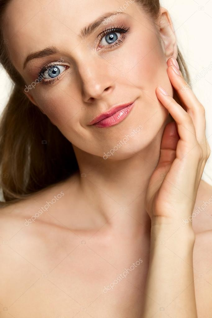 Beautiful young woman touching by hand her face — Stock Photo #12603243