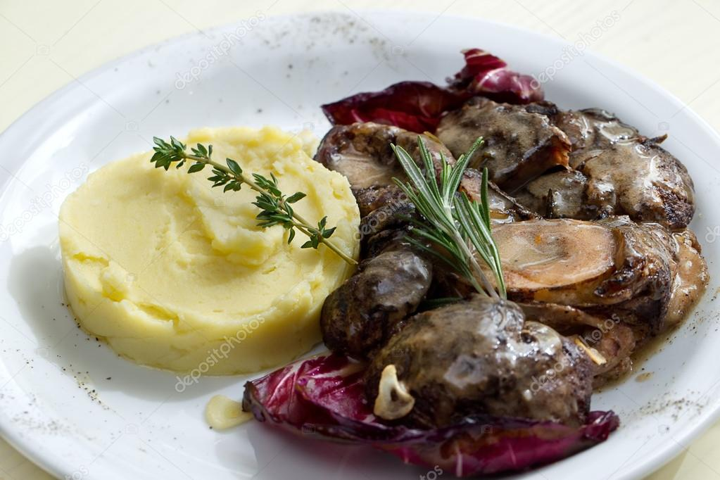 Meat with sauce and mashed potatoes on a plate  Stock Photo #21157057