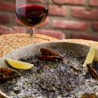 Black spanish paella - ストック写真