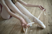 Putting on ballet shoes — Stok fotoğraf