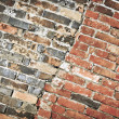 Half new and half old brick wall. — Stock Photo