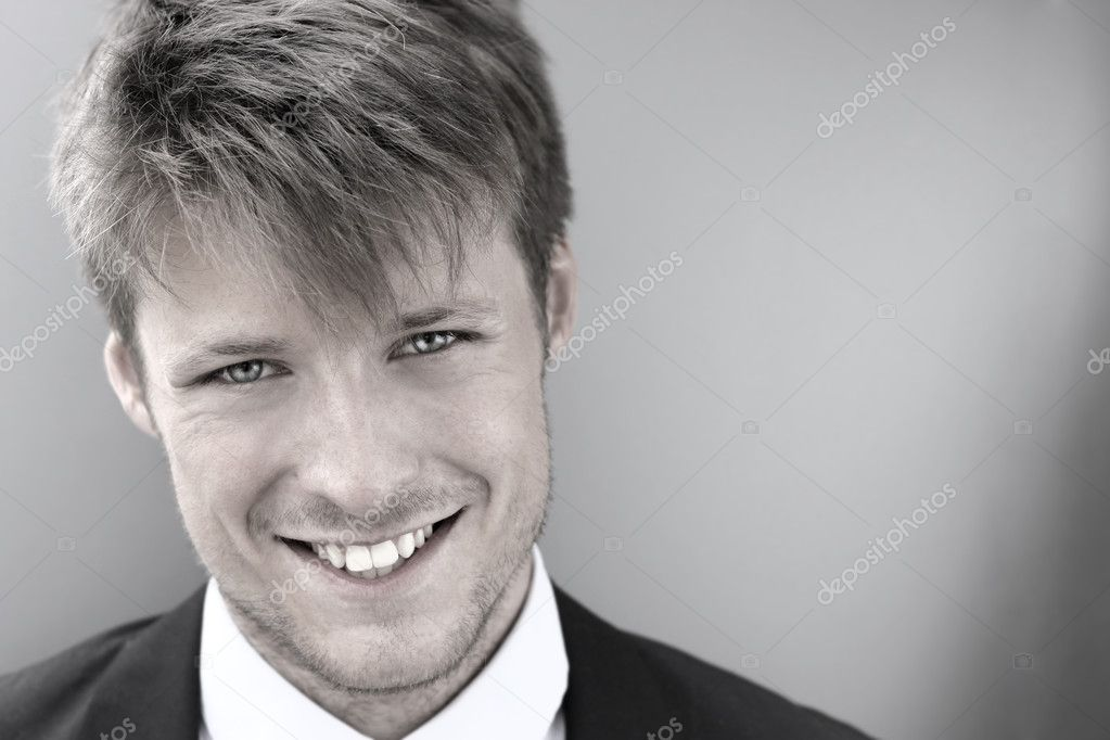 Stylized cool portrait of a happy smiling young businessman  Stock Photo #12461976