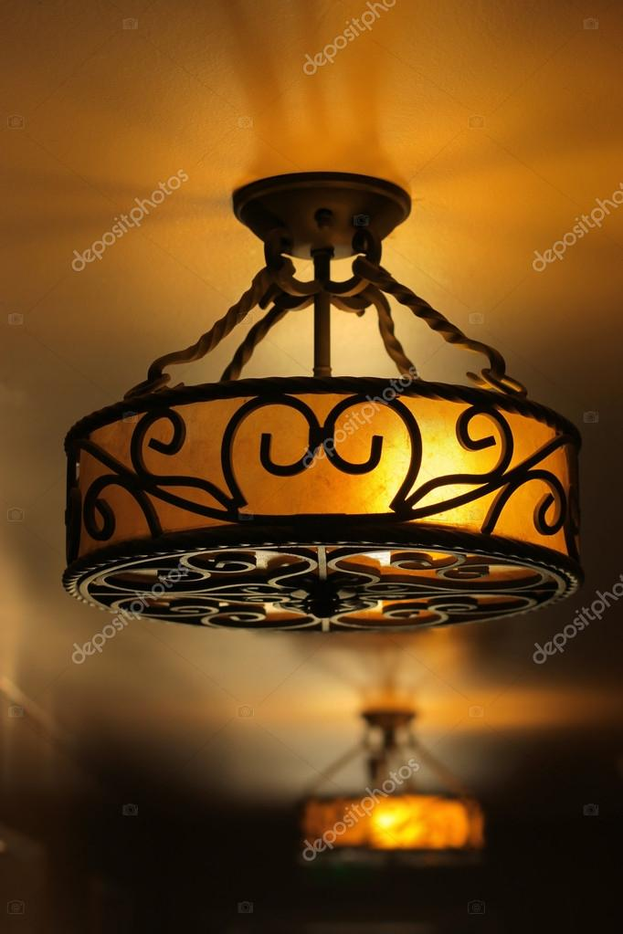 Vintage art deco ceiling lamp fixture in dark hallway  Stock Photo #13127331