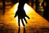 Hand in dark — Stock Photo
