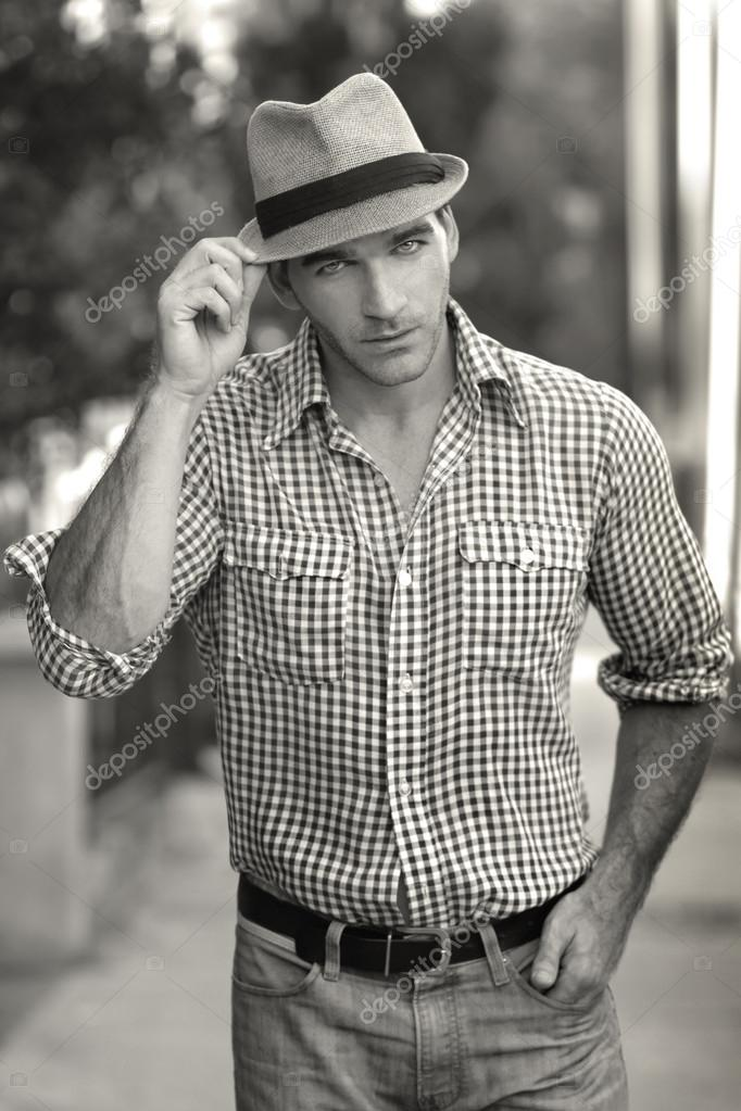 Portrait of a handsome fashionable man in hat outdoors  Stock Photo #13184170