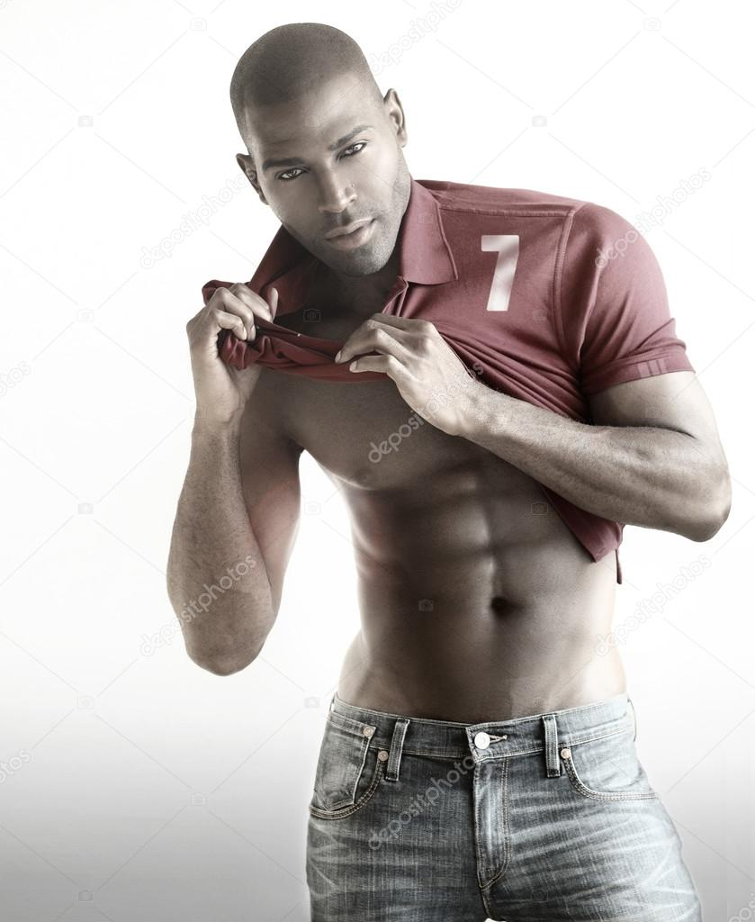 Very well built sexy male model showing his abs in fashionable active sportwear against whitebackground with copy space — Stock Photo #20063701