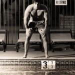 Vintage nostalgia man at pool — Stock Photo
