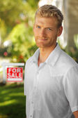 Young man in real estate — Stock Photo