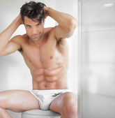 Sexy guy undressed — Stock Photo