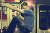 Young man on subway — Stock Photo