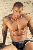 Hot guy at beach — Stock Photo