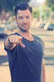 Young man pointing — Stock Photo