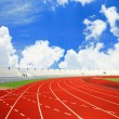 Running track with lanes over sky and clouds  — Stock Photo