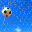 Stock Photo: Soccer ball in goal net