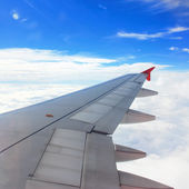 Airplane Wing in Flight, looking through window — Stock Photo