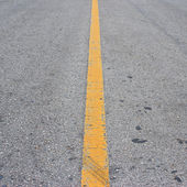 New asphalt texture with white dashed line — Stock Photo