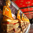 Golden buddhas arcade in bangkok — Stock Photo