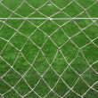 White football net, green grass — Stock Photo