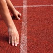 Athlete in the starting blocks, ready to go — Stock Photo #37608455