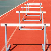 Running tracks with three hurdles set up for training — Stock Photo